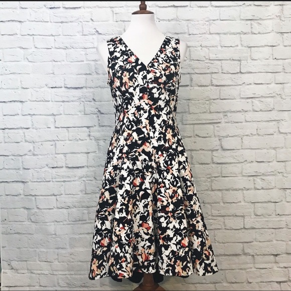 394b9bf5db WHBM Fit and Flare Hi Lo Hem Floral Print Dress 6.  M 5a90c9d9b7f72bfb9a0a38e7. Other Dresses you may like. White House Black  ...
